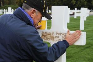 Scott sanding James grave