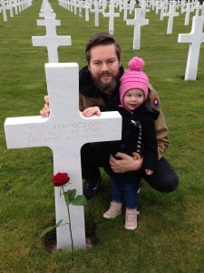 Yuri and his daughter Nora at one of the graves he adopted.